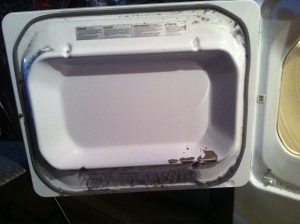 Lint build up inside your dryer door is a sign you need your dryer vent cleaning